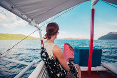 Woman on boat approaching tropical island Stock Photography