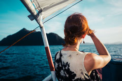 Woman on boat approaching tropical island Royalty Free Stock Photography