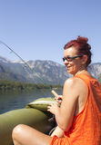 Woman in boat, fishing on the lake Stock Photos