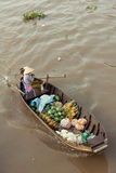 Woman on boat floating down Mekong river , Vietnam. Can Tho, Vietnam - APRIL 2: Woman on boat floating down Mekong river at Can Tho Floating Market, Can Tho Royalty Free Stock Image