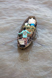 Woman on boat floating down Mekong river , Vietnam Stock Image