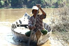 Woman on a boat in floating village Stock Photo