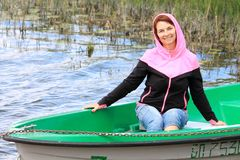 Woman in a boat. On the lake royalty free stock photo