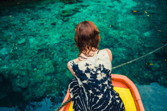 Woman on boat looking at clear blue water Royalty Free Stock Images