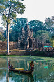 Woman boat moat south gate bridge Angkor Thom Cambodia Royalty Free Stock Photo