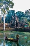 Woman boat moat south gate bridge Angkor Thom Cambodia Royalty Free Stock Photo