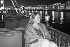 The woman on the boat at night in Dubai Royalty Free Stock Images