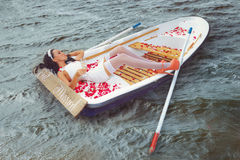 Woman in a boat outdoors Stock Photos