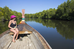Woman in boat prow Royalty Free Stock Image