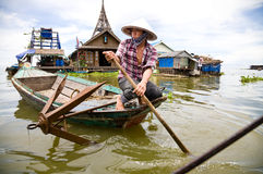 Woman in boat, Tonle Sap Royalty Free Stock Photos