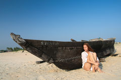 Woman and boat Stock Image