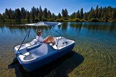 Woman boating Royalty Free Stock Images