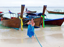 Woman with boats Royalty Free Stock Photo
