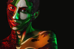 Woman with body art on face and clay in fashion image Stock Photography