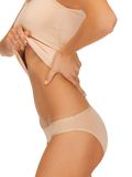 Woman body in beige cotton undrewear Royalty Free Stock Images