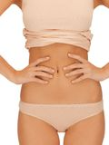 Woman body in beige cotton undrewear Royalty Free Stock Photography