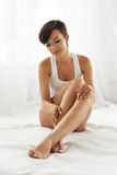 Woman Body Care. Beautiful Girl Touching Long Legs Soft Skin. Woman Body Care. Beautiful Happy Healthy Girl Touching Sexy Long Legs. Female Enjoying Perfect Royalty Free Stock Images