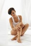 Woman Body Care. Beautiful Girl Touching Long Legs Soft Skin. Woman Body Care. Beautiful Happy Healthy Girl Touching Sexy Long Legs. Female Enjoying Perfect Royalty Free Stock Photo