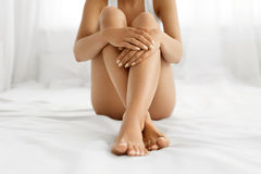 Woman Body Care. Close Up Of Long Legs With Soft Skin And Hands Royalty Free Stock Images