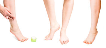 Woman body care - putting cream on her leg royalty free stock image