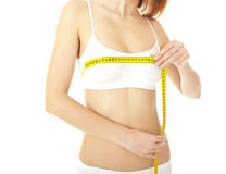 Woman body care and yellow measure Stock Images