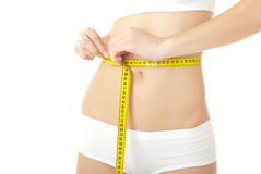 Woman body care and yellow measure Stock Photo