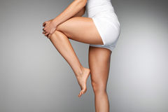 Woman Body. Close Up Of Beautiful Female Legs With Pain In Knee. Woman Body Part. Closeup Of Beautiful Female Hands Holding Her Long Slender Leg. Close-up Of Stock Image