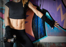 Woman body close up over a graffiti wall Royalty Free Stock Photography