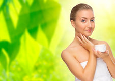 Woman with body cream on floral background Royalty Free Stock Image
