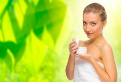 Woman with body cream on floral background Stock Photo