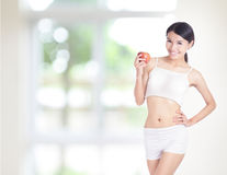 Woman body and hand holding red apple Royalty Free Stock Photos