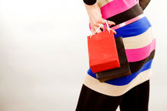 Woman body hand and two shoping bags. Part woman body hand and two shoping bags royalty free stock photography