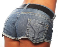 Woman body in jean shorts. Royalty Free Stock Images
