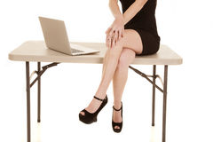 Woman body and legs sit table computer royalty free stock photography