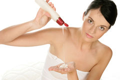Woman with body lotion Stock Photos