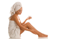 Woman with body lotion Stock Images