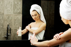 Woman with body lotion. Royalty Free Stock Images
