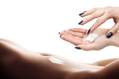 Woman with body lotion. Hands smeared cream ob belly Stock Photography