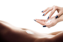 Woman with body lotion. Hands smeared cream ob belly Stock Images