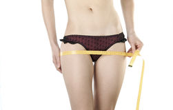 Woman body measured. Woman body part is being measured Royalty Free Stock Images