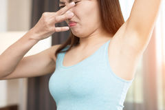 Woman with body odor Royalty Free Stock Photography