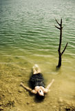 Woman body over the water. Young woman body over lake waters, closed eyes Stock Photos