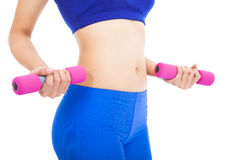 Woman body part with fitness dumbell Royalty Free Stock Photography