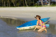 Woman body sexy bikini and canoe morning on beach Stock Photos