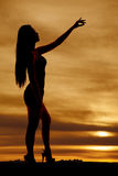 Woman body silhouette hand up and out Stock Photography