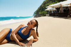 Woman Body In Summer. Girl In Bikini Tanning On Beach Stock Photos