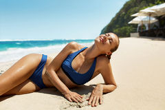 Woman Body In Summer. Girl In Bikini Tanning On Beach Royalty Free Stock Photos