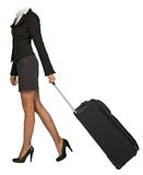 Woman body walking with flight bag Royalty Free Stock Photo