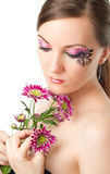 Woman with bodyart butterfly on face with  flower Royalty Free Stock Image