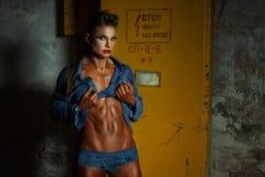 Woman bodybuilder demonstrates body. royalty free stock photos